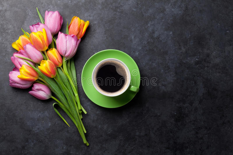 Fresh colorful tulip flowers and coffee royalty free stock image