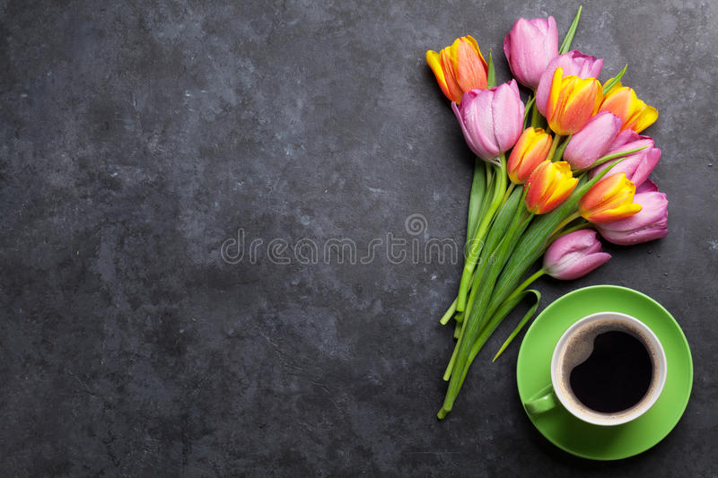 Fresh colorful tulip flowers and coffee royalty free stock photography