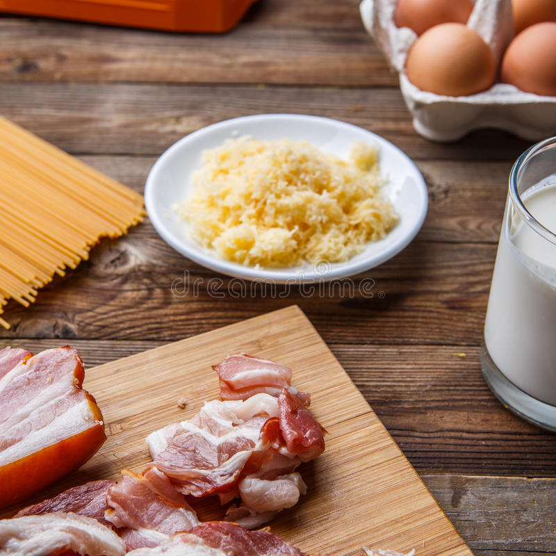Fresh components for pasta carbonara. On wooden table stock photography
