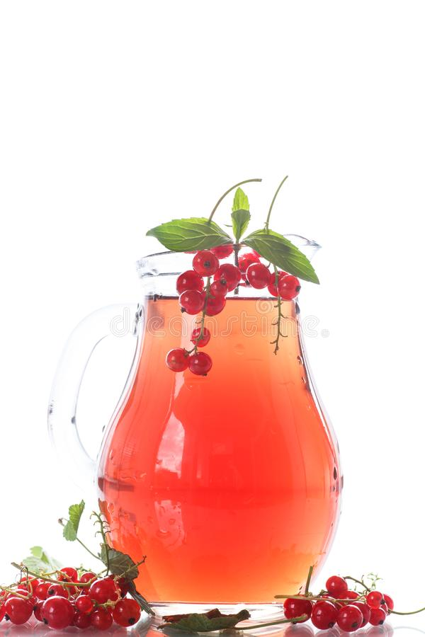 Fresh compote of ripe red currant. In a glass decanter royalty free stock image