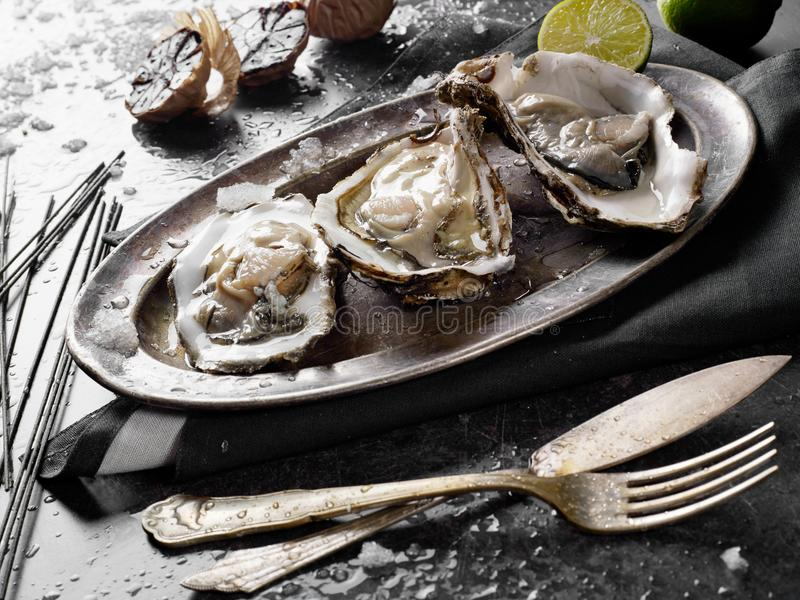 Fresh cooked oysters stock images