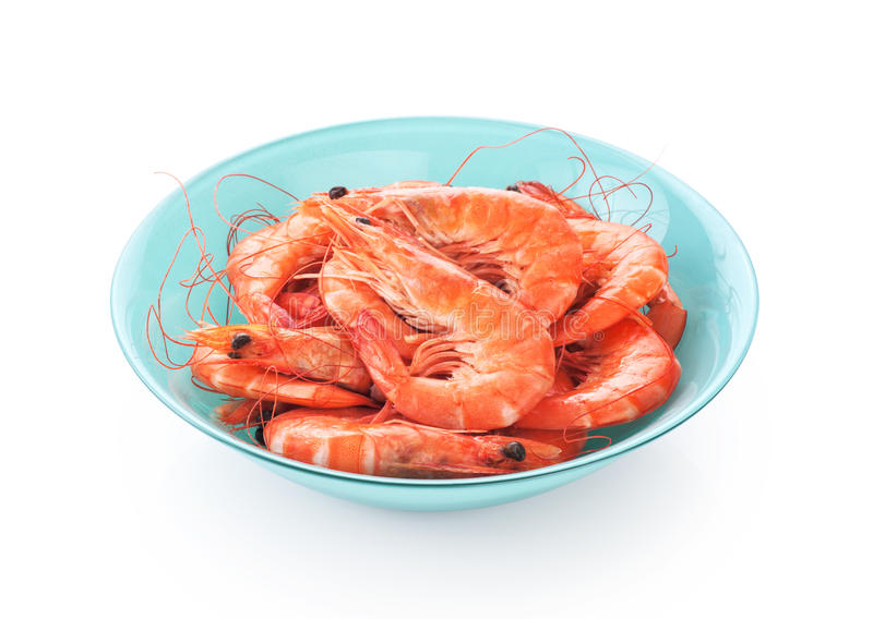 Fresh cooked shrimp on a plate isolated on white background. Seafood royalty free stock photo