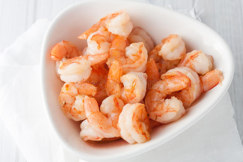 Fresh cooked shrimp in white bowl stock photography