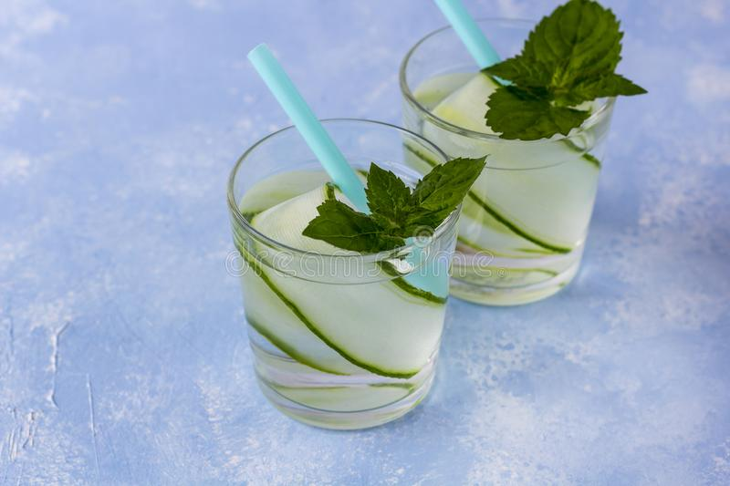 Fresh cool detox drink with cucumber, lemonade in a glass with a mint royalty free stock photography