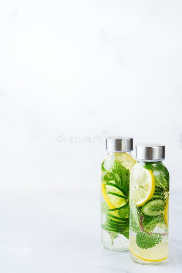Fresh cool lemon cucumber mint infused water detox drink stock image