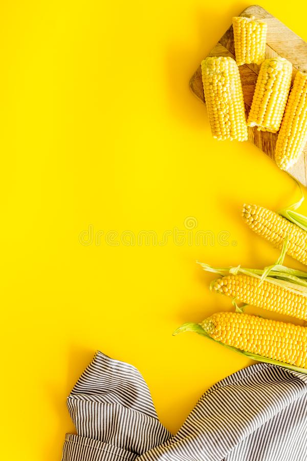 Fresh corn as farm food on yellow background top view space for text royalty free stock photos