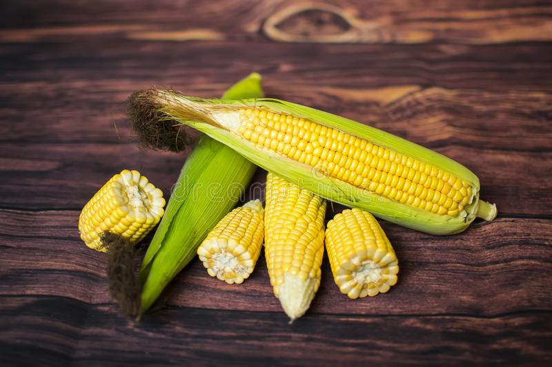 Fresh corn on cobs on wooden table, closeup, top view. royalty free stock photos