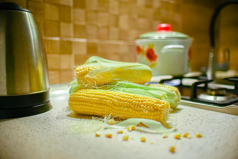 Fresh corn in the kitchen. Corncob. Rustic style.  stock photos