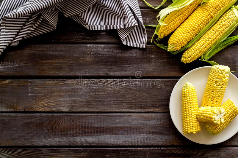 Fresh corn on plate as farm food on wooden background top view space for text stock image