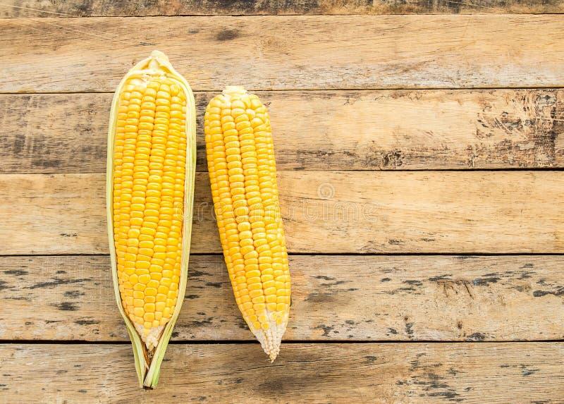 Fresh corn on wooden table background. Fresh corn on a wooden table background stock photo
