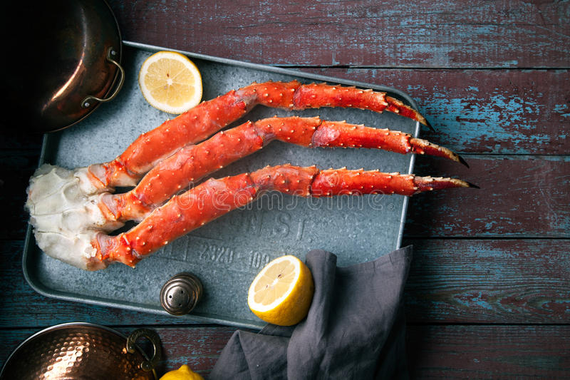 Fresh crab claws on vintage wooden background stock photo