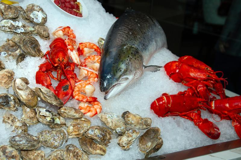 Fish Seafood Market and Restaurant. Fresh crab, lobster, clams, fish, shrimp, and other seafood adorn this display at a seafood market and food restaurant stock images
