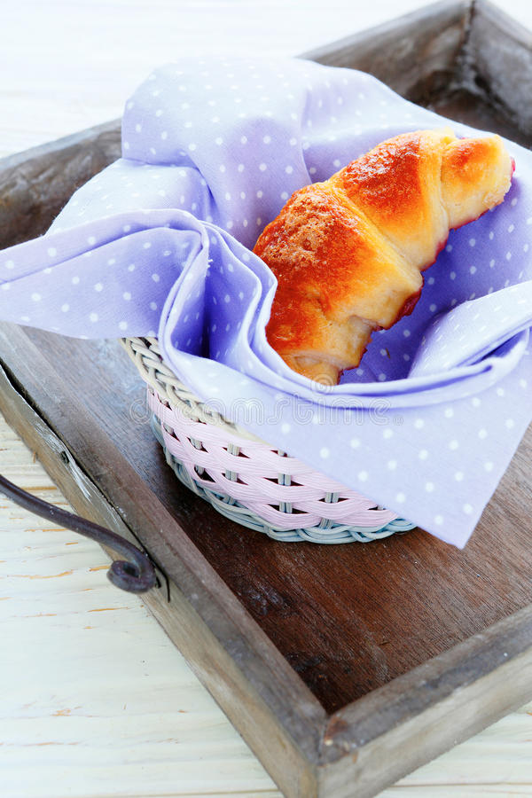 Fresh croissant in the basket royalty free stock photography