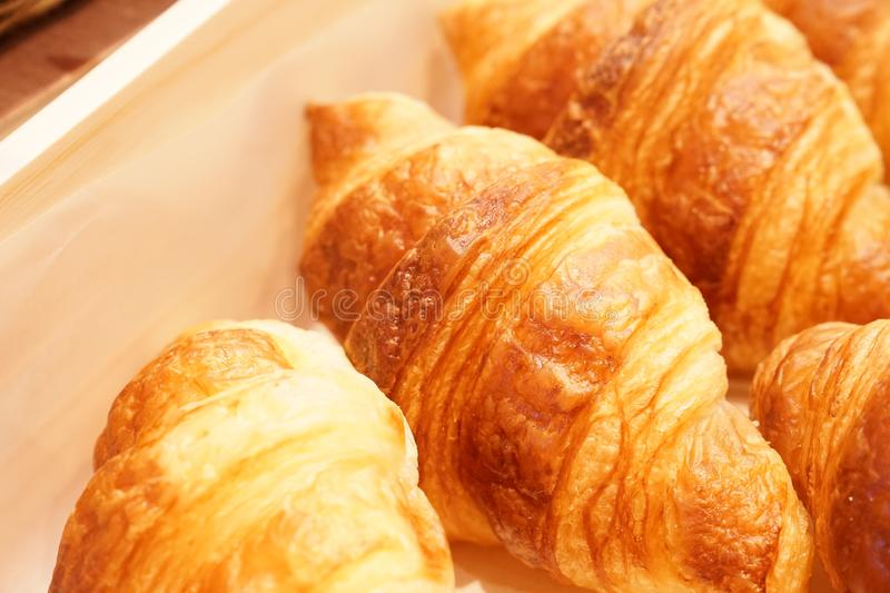 Fresh croissant in the basket, ready to serve stock images