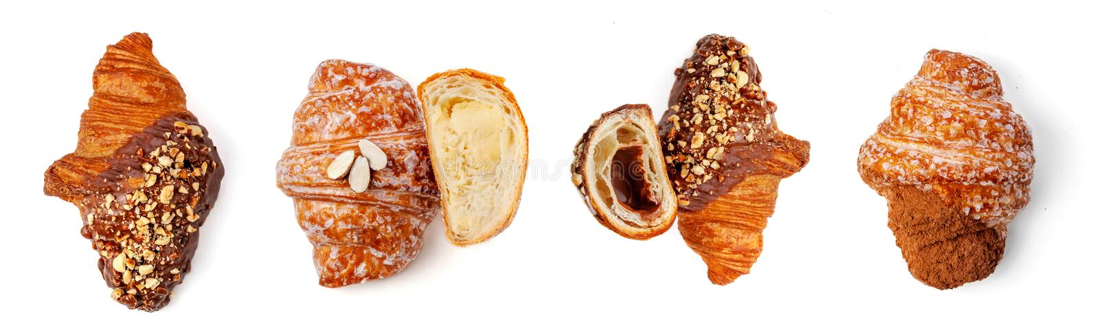 Fresh Croissant with chocolate and nuts isolated on white background, close up. View from above royalty free stock images