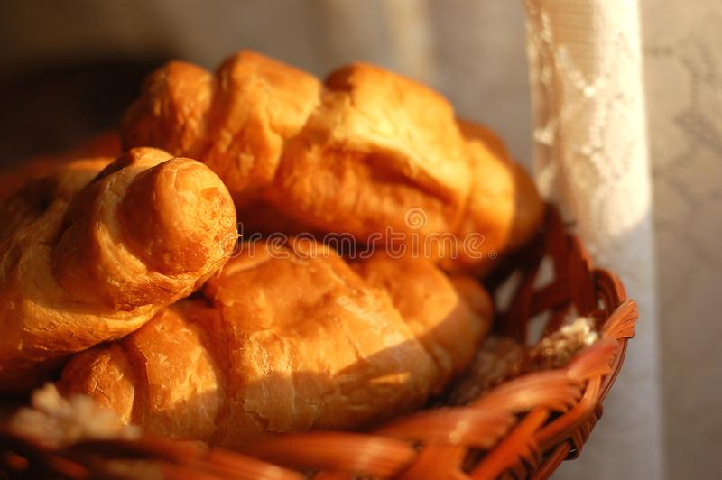 Fresh croissants in basket royalty free stock photo