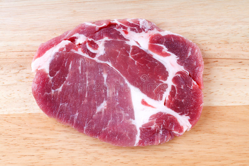 Fresh crude pork neck meat steak on wood background royalty free stock images