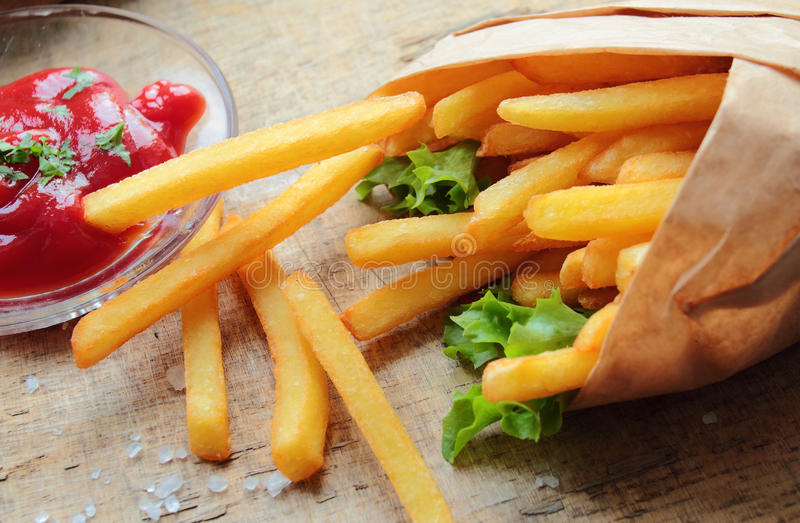 Fresh crunchy fries. With ketchup royalty free stock images