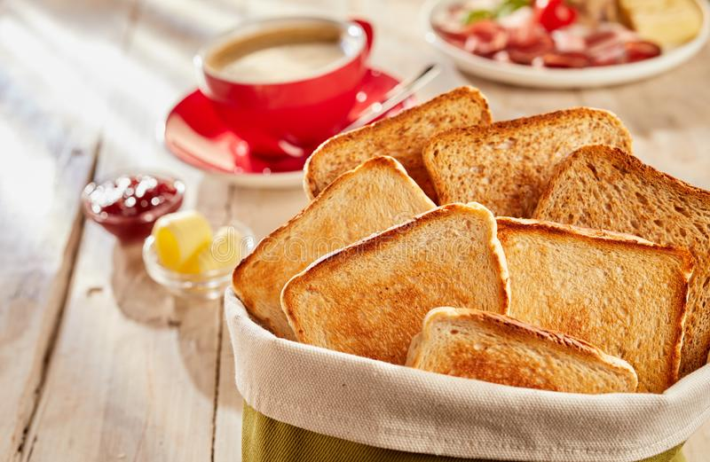 Fresh crunchy toasts in bag, served with coffee stock photos