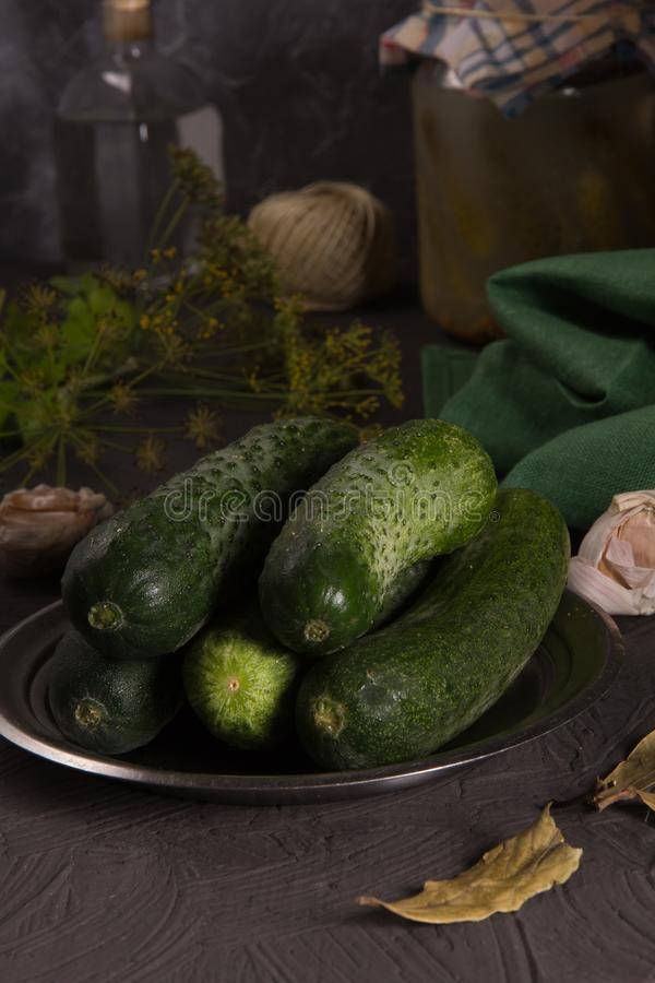 Fresh cucumbers on the kitchen table for home canning royalty free stock image