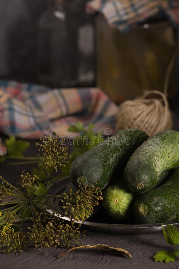 Fresh cucumbers on the kitchen table for home canning stock photography