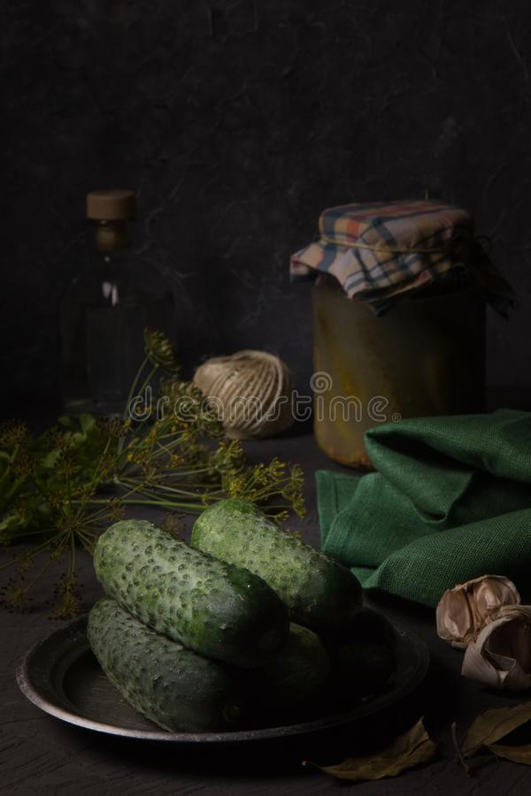 Fresh cucumbers on the kitchen table for home canning royalty free stock images