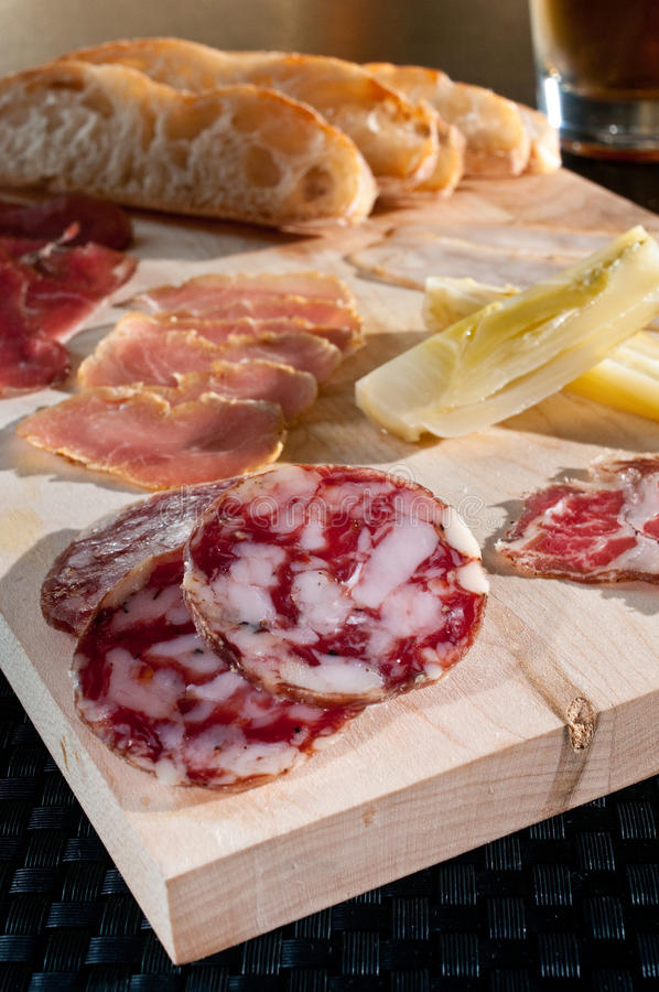 Fresh cured meats. Charcuterie plate with fresh cured meats stock images