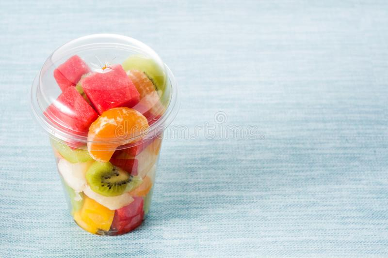 Fresh cut fruit in a plastic cup royalty free stock photos