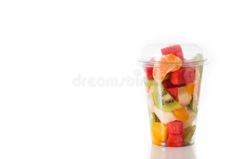Fresh cut fruit in a plastic cup royalty free stock photography