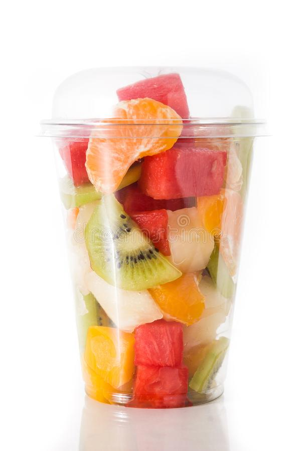 Fresh cut fruit in a plastic cup royalty free stock images