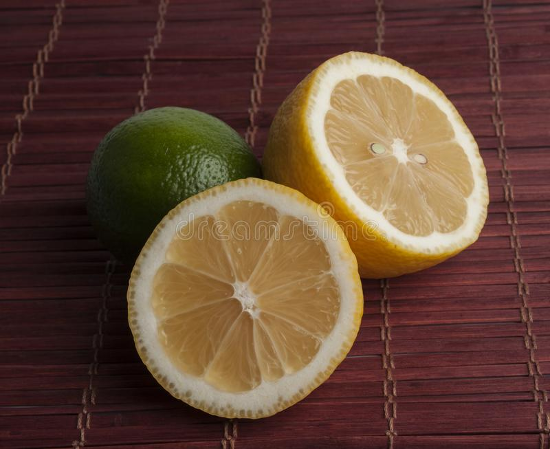 Fresh cut lemon and lime stock images