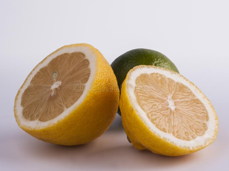 fresh cut lemon and lime stock photos