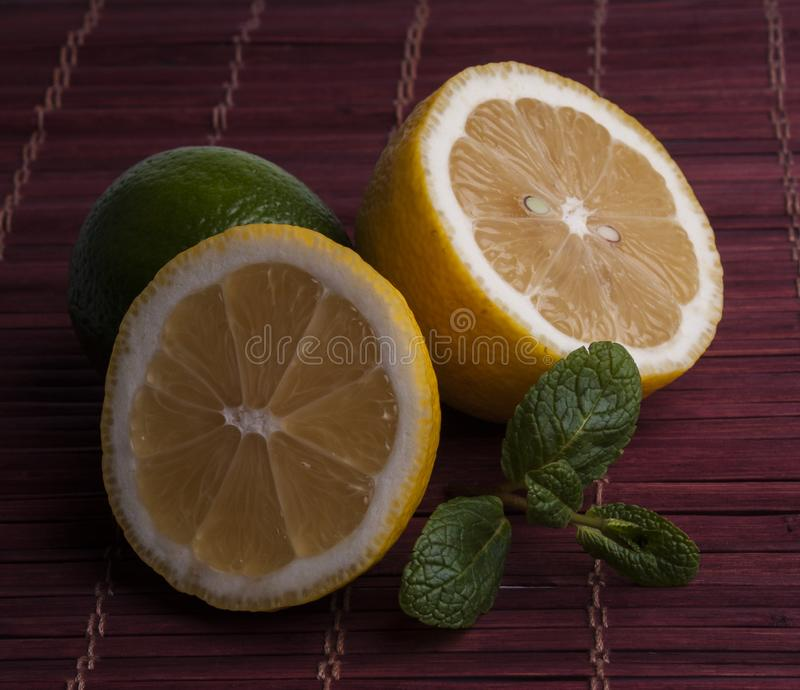 fresh cut lemon and lime with mint stock images