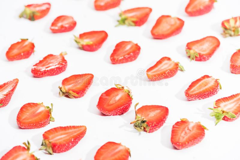 Fresh cut strawberries in rows royalty free stock image