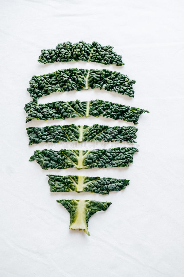 Fresh cutting green organic kale leaves on white background. top stock photo