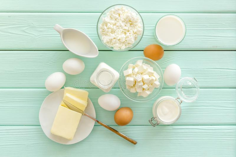Fresh dairy products with milk, cottage, eggs, butter, yougurt on mint green wooden background top view royalty free stock image