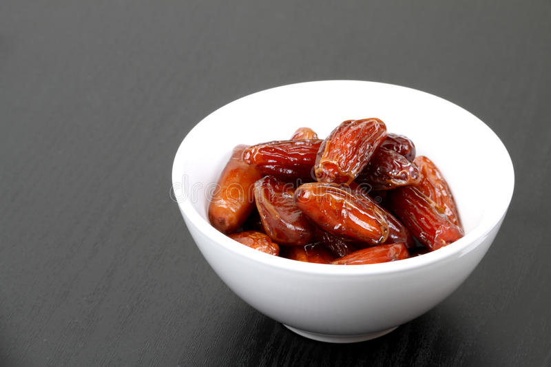 Fresh date fruit in a white bowl