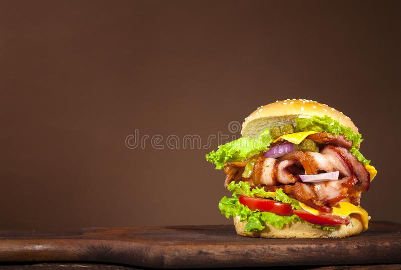 Fresh delicious big burger on a wooden background stock photo