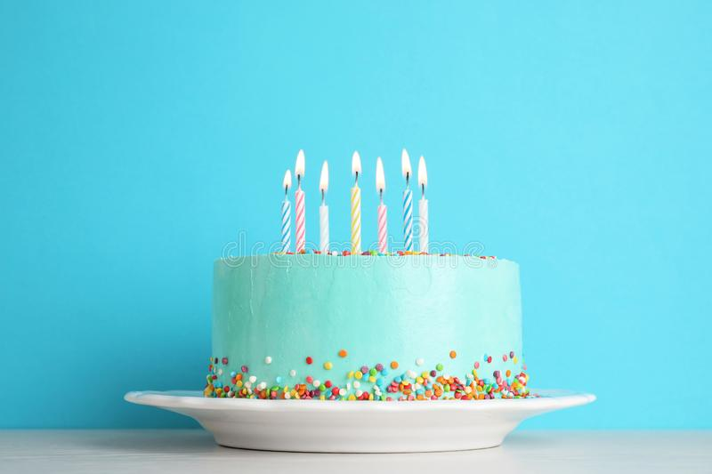 Fresh delicious birthday cake with candles on table stock photo
