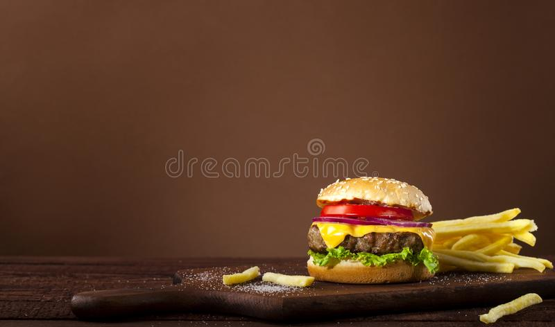 Fresh delicious burger on a wooden background royalty free stock photos
