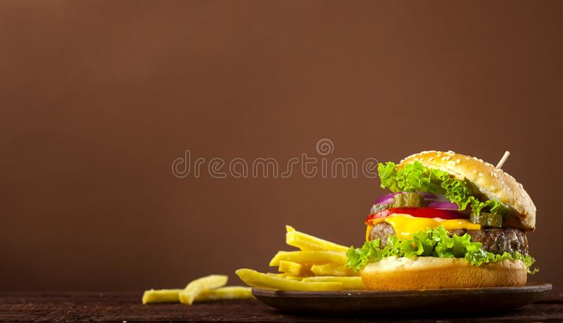 Fresh delicious burger on a wooden background stock photography