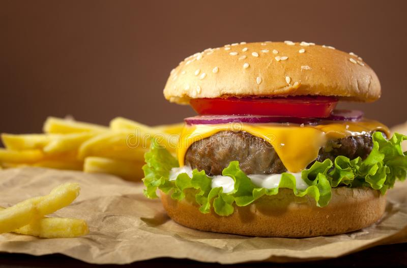 Fresh delicious burger on a wooden background stock image