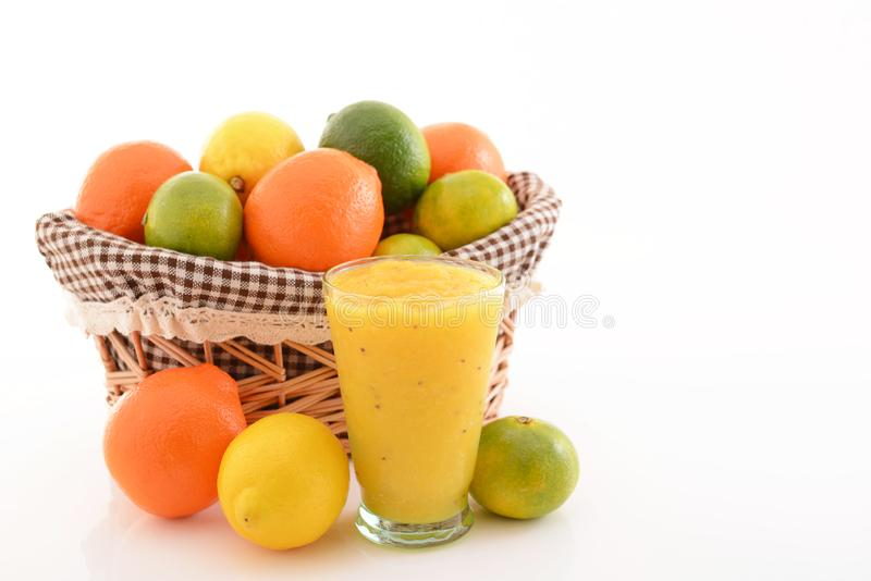Fresh citrus fruits. Fresh and delicious citrus fruits with a glass of juice stock photography