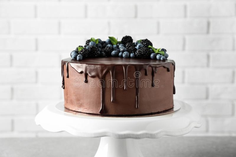 Fresh delicious homemade chocolate cake with berries on table stock image