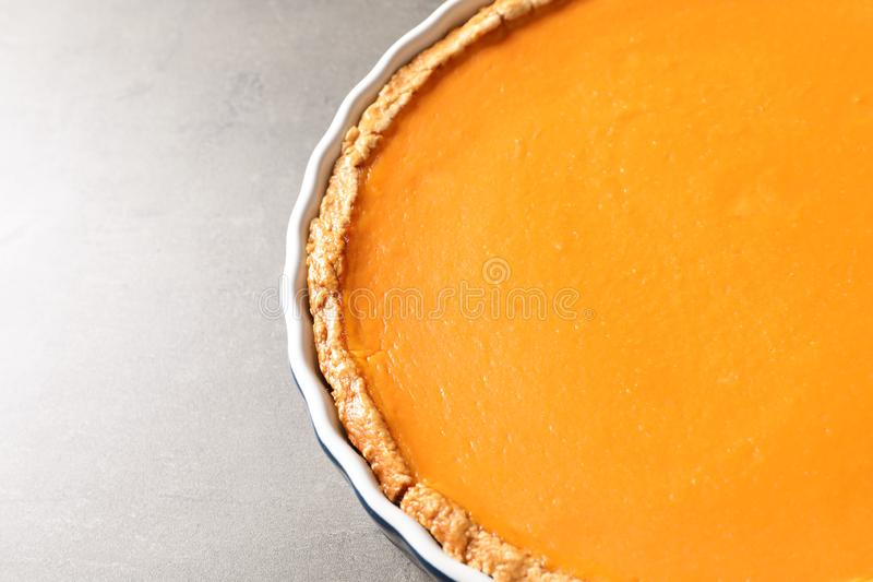 Fresh delicious homemade pumpkin pie on gray background stock photography