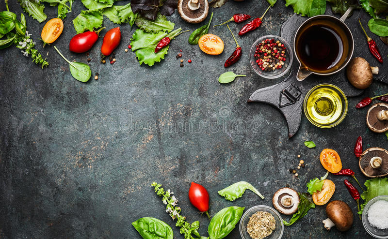 Fresh delicious ingredients for healthy cooking or salad making on rustic background, top view, banner. Diet or vegetarian food concept stock photo