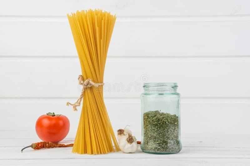 Fresh Delicious Italian Pasta Spaghetti Tide Together With Grunge Natural Flux Tie With Bio Organic Fresh Tomato Red Chilli stock image