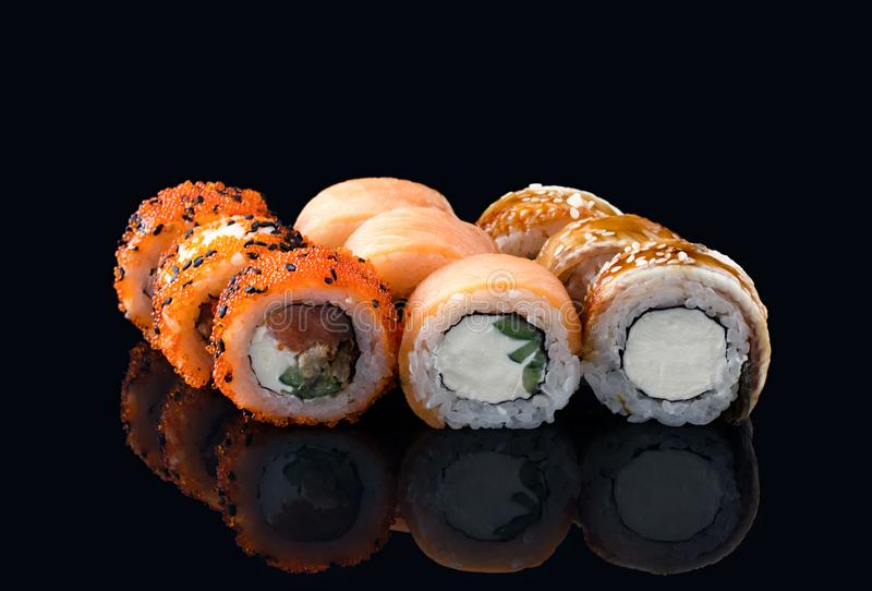 Japanese rolls on a dark background stock photo
