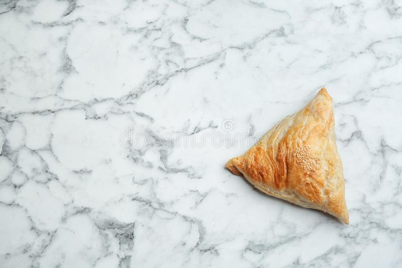 Fresh delicious puff pastry on white marble table, top view. Space for text royalty free stock photography