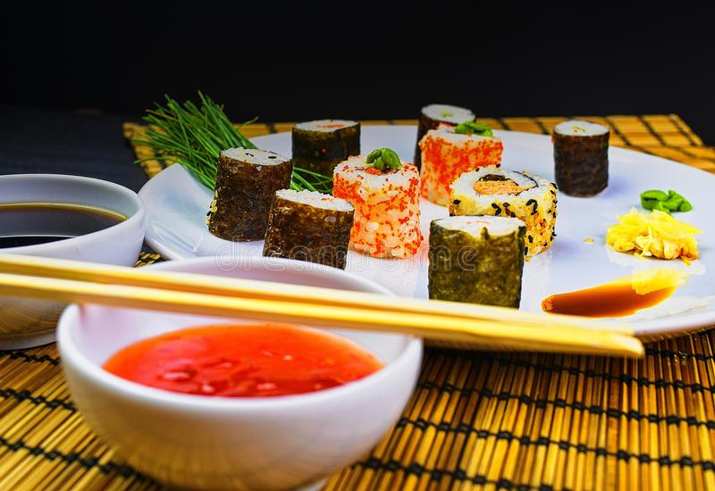 Fresh and delicious sushi Japanese food. Image of Japanese food. Sushi rolls served on a plate in a restaurant stock images